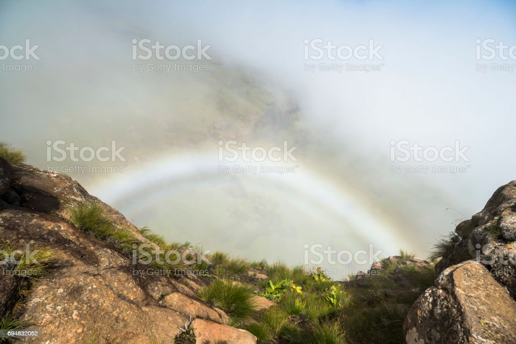 Rainbow inside clouds on Sentinel Hike, Drakensberge, South Africa stock photo