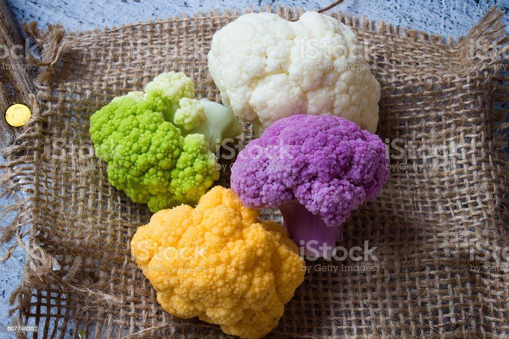 Rainbow of organic cauliflower from the local market. stock photo