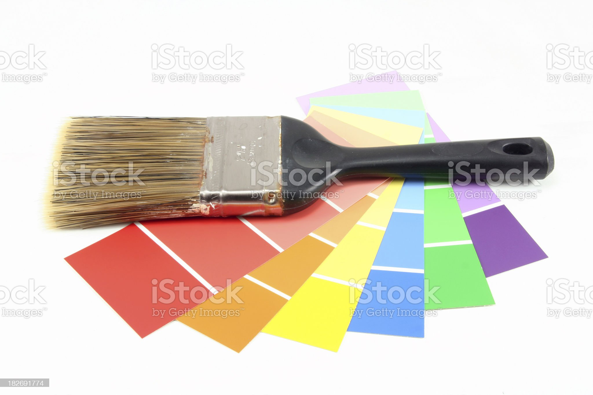 Rainbow of Paint Chips with Brush royalty-free stock photo