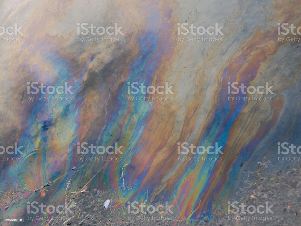 Rainbow Oil Pollution Slick on Lake Pond Water stock photo