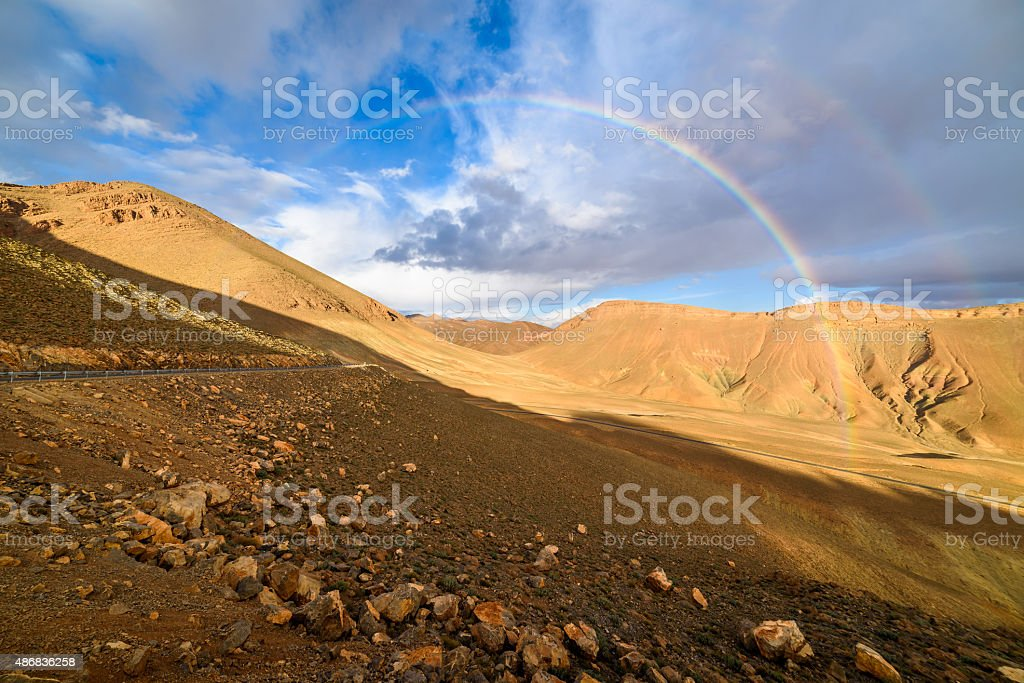 Rainbow on a mountain road in High Atlas, Morocco stock photo