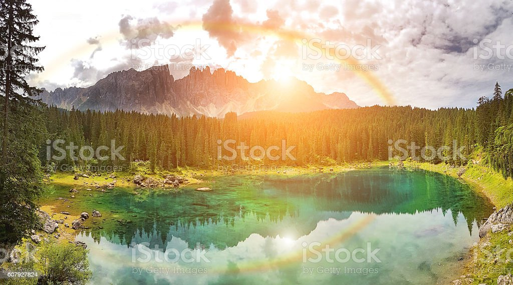 Rainbow on Carezza Lake  - Trentino Alto Adige - Italy stock photo