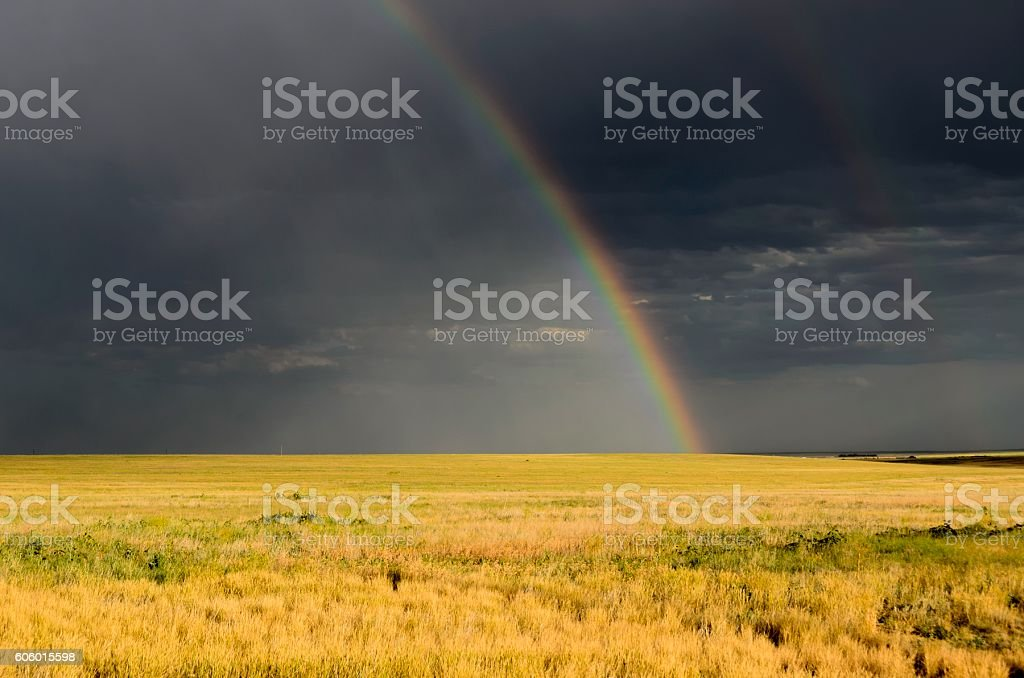 Rainbow on Colorado Farm stock photo