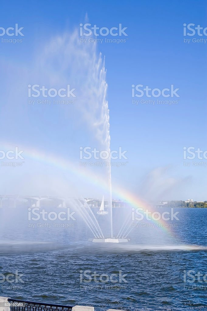Rainbow on Dnepr river in Dnepropetrovsk city. stock photo