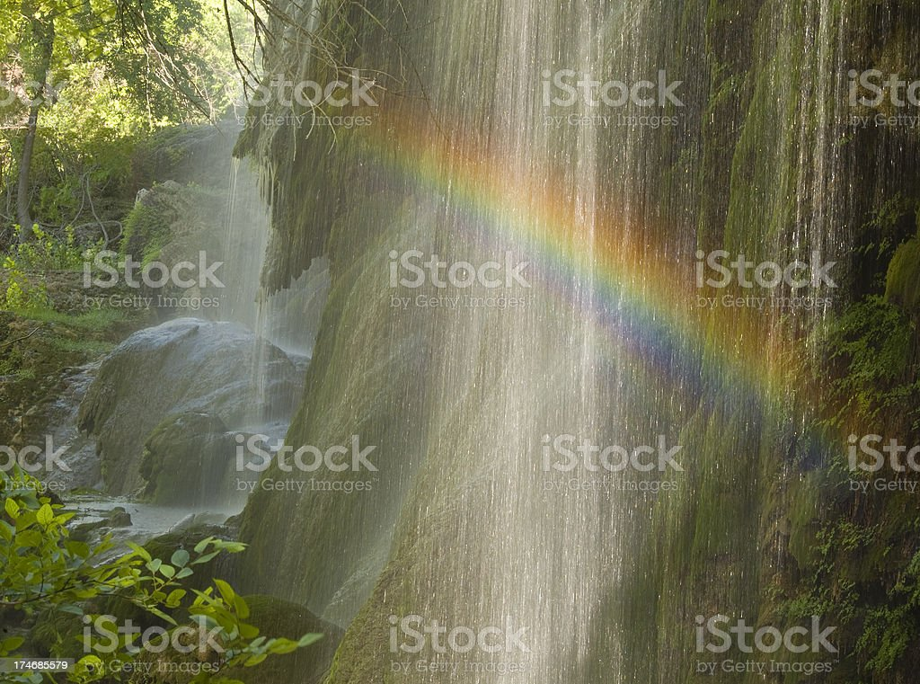 Rainbow on Gorman Falls at Colorado Bend State Park stock photo
