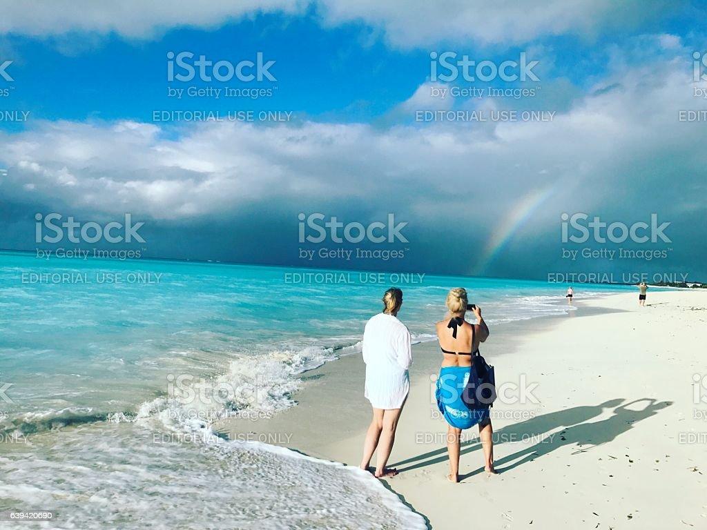 Rainbow on Grace Bay Beach. Turks and Caicos Islands stock photo