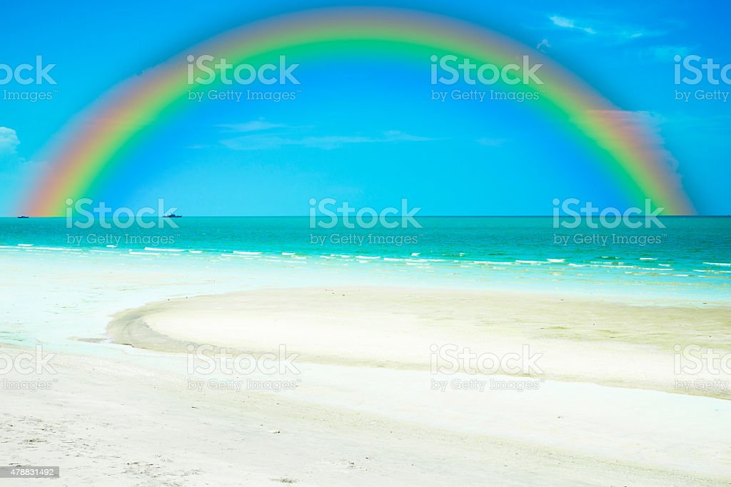 rainbow on sky with sea and beach. royalty-free stock photo