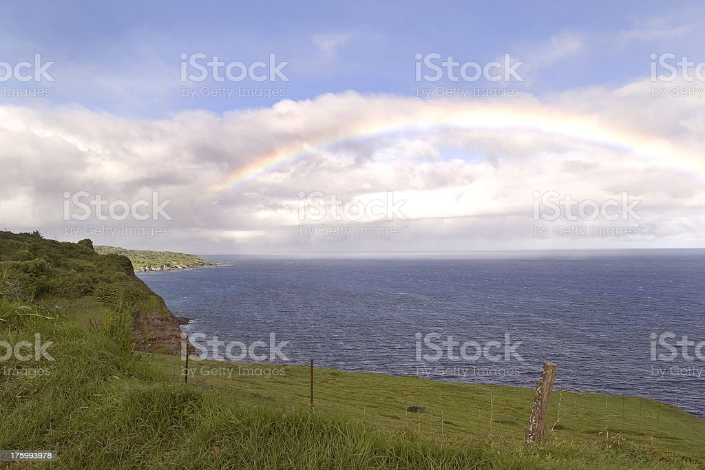 Rainbow on the horizon over tha Pacific on the Island of Maui stock photo