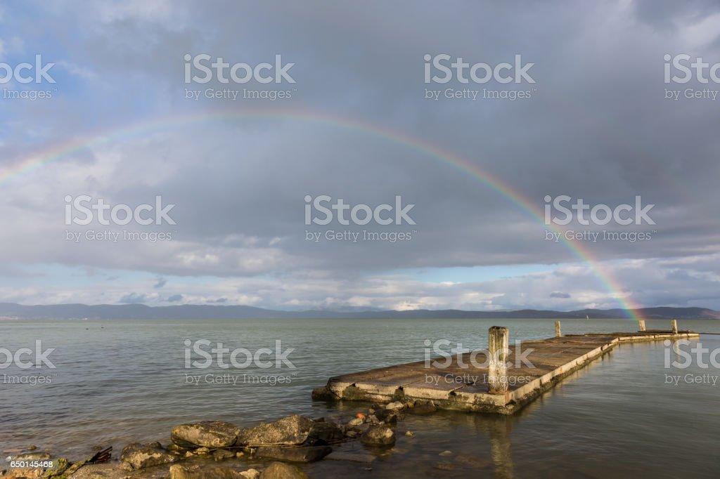 Rainbow over a pier stock photo