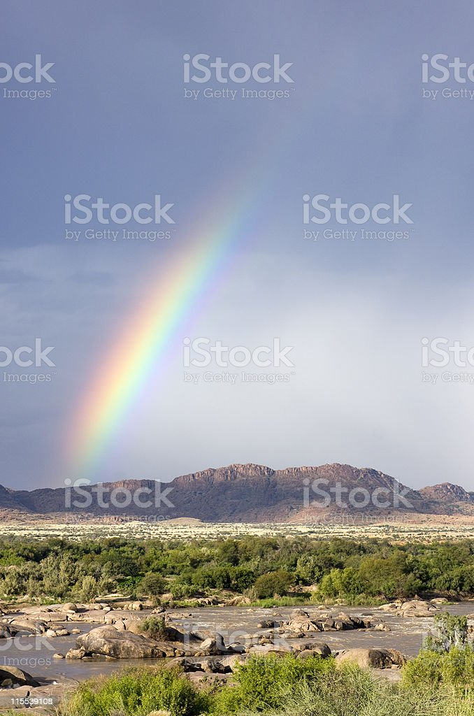 Rainbow over a river valley in South Africa stock photo