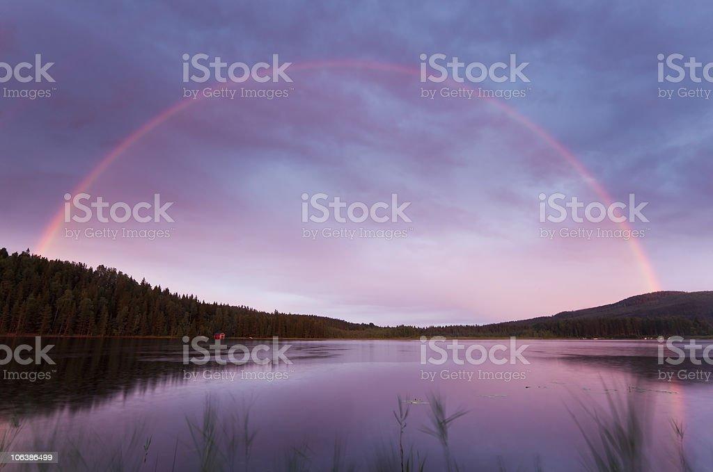Rainbow over a swedish lake royalty-free stock photo