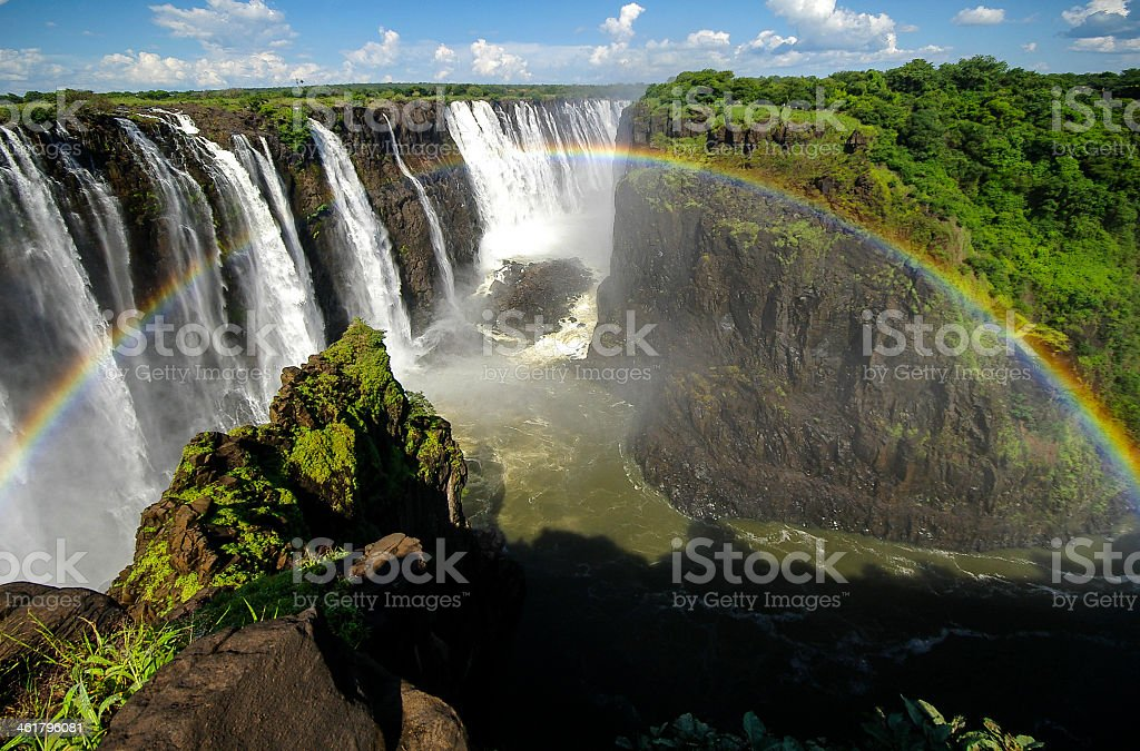 Rainbow over a view of Victoria Falls stock photo