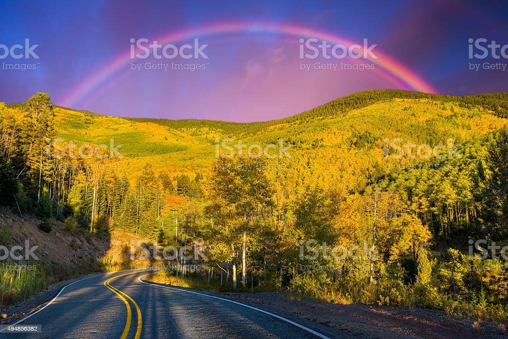 Rainbow Over an Aspen Forest stock photo