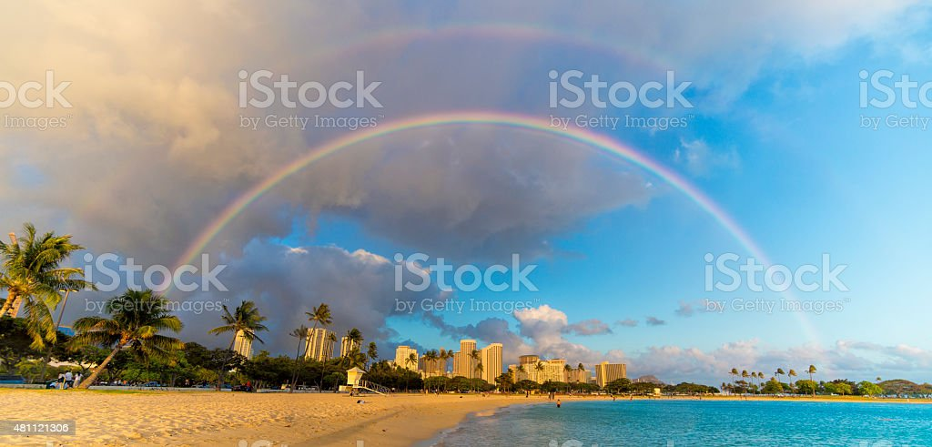 Rainbow Over Beachfront Buildings in Hawaii stock photo