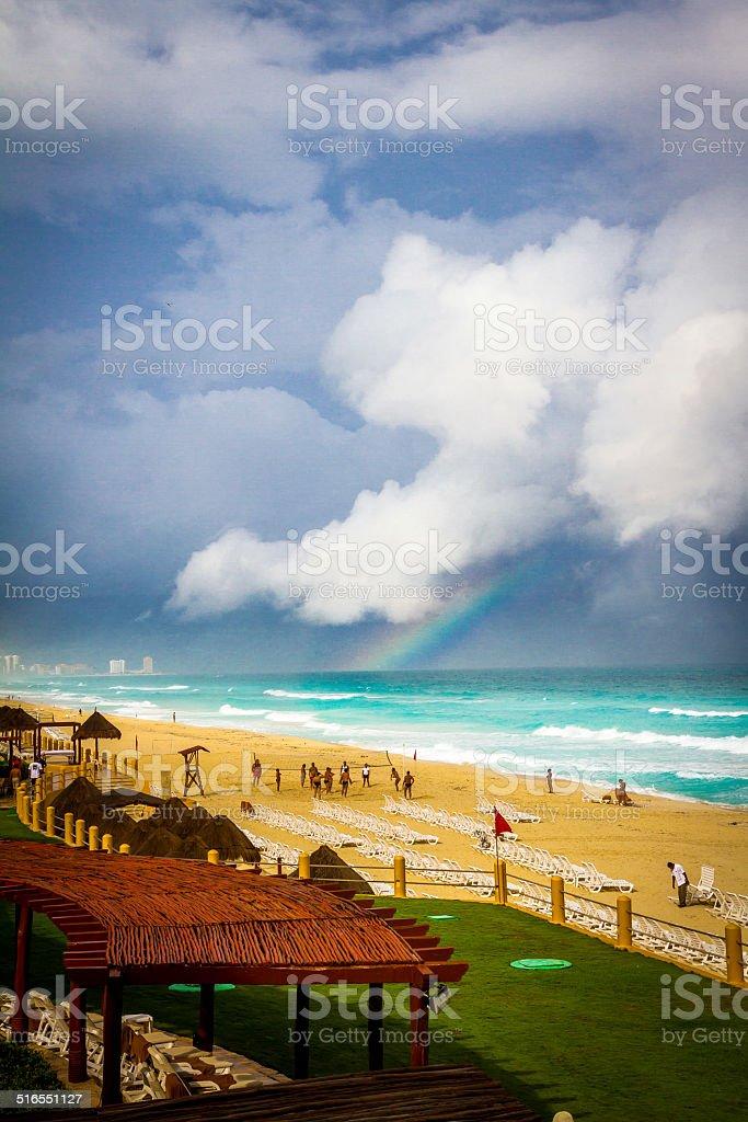 Rainbow over Cancun Beach stock photo