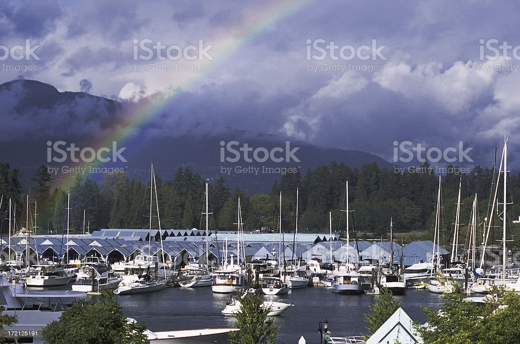 Rainbow over Coal Harbor, Vancouver, Canada. royalty-free stock photo