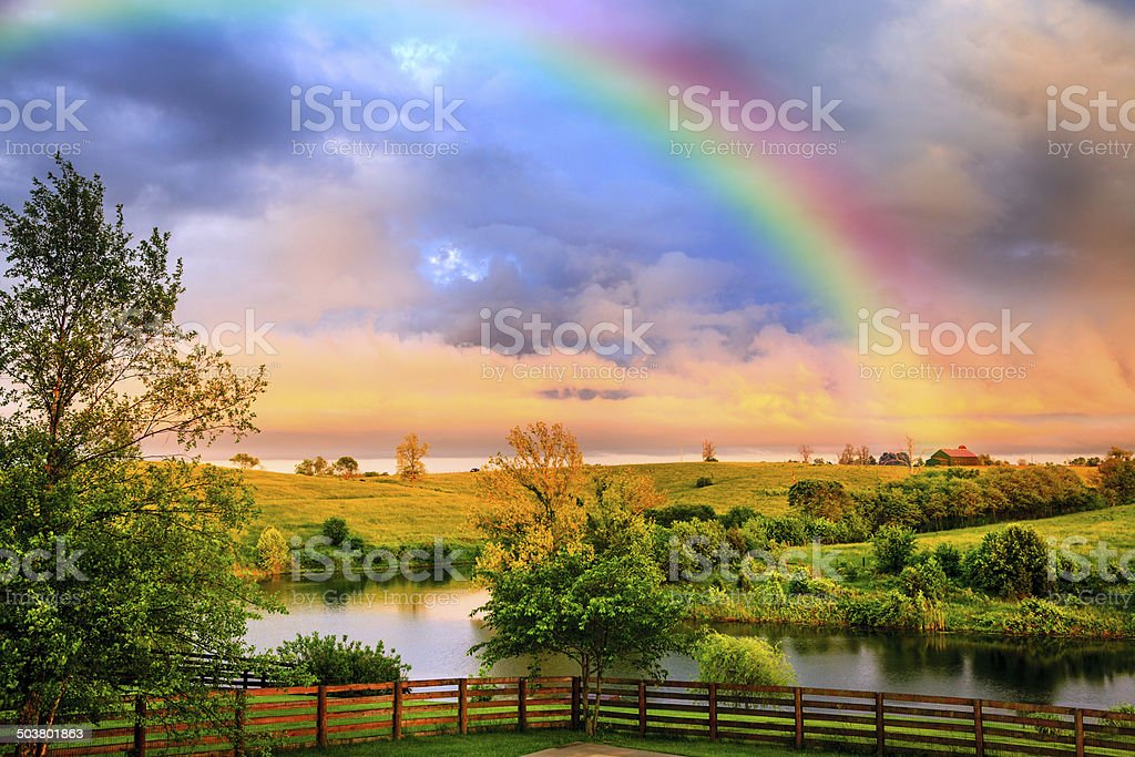 Rainbow over countryside stock photo