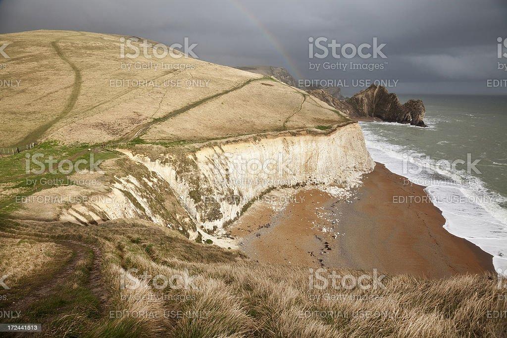 Rainbow over Durdle Door on the Dorset Jurassic Coast royalty-free stock photo