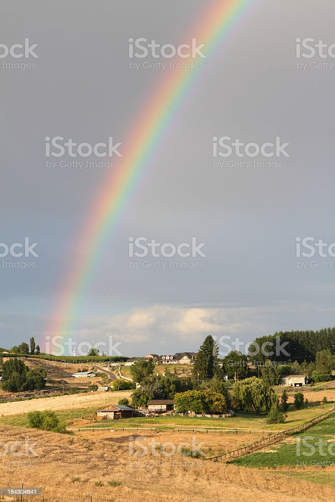 Rainbow over farms royalty-free stock photo