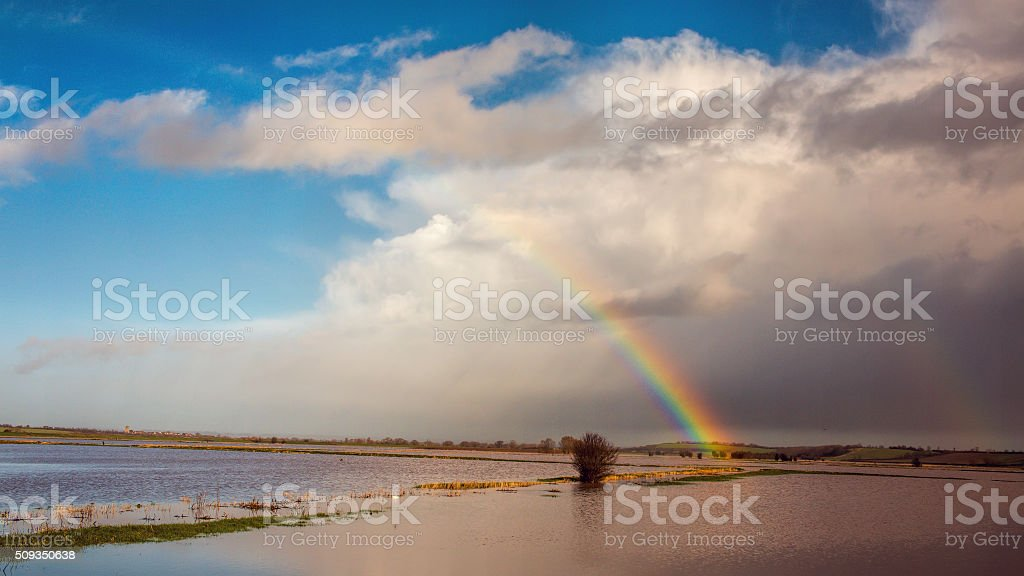 Rainbow Over Flooded Land After Storm stock photo