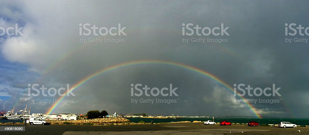 rainbow over fremantle harbour stock photo