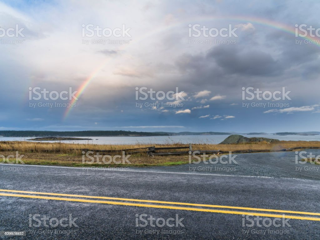 Rainbow over highway stock photo