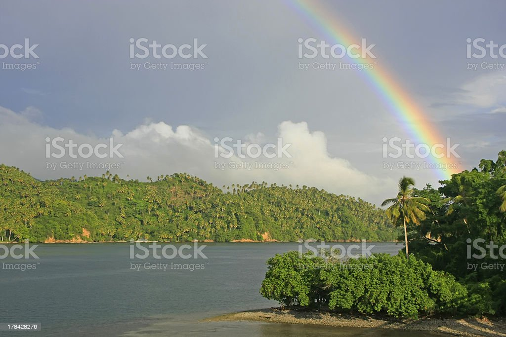 Rainbow over hills of Samana stock photo
