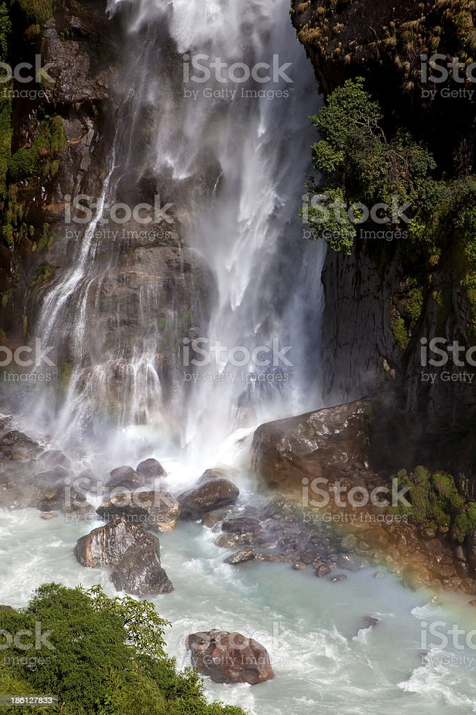Rainbow over Himalayan waterfall. royalty-free stock photo