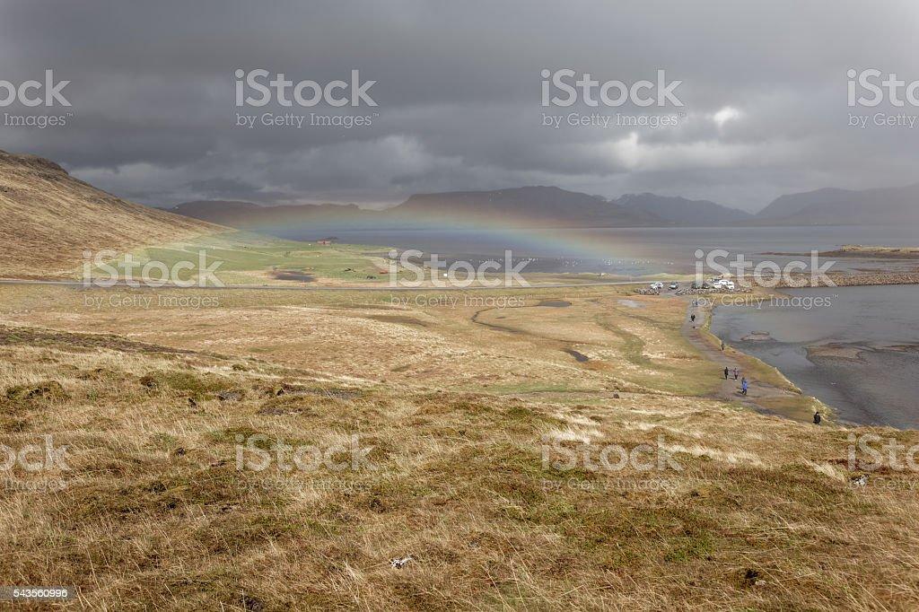 Rainbow over Kirkjufellfossi stock photo