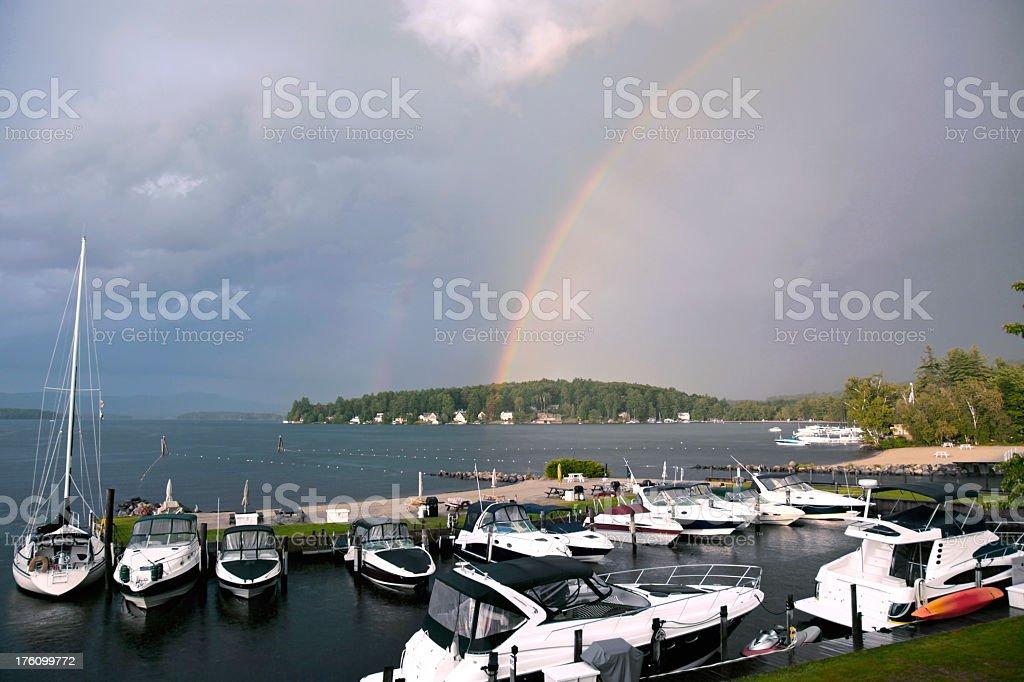Rainbow over lake royalty-free stock photo
