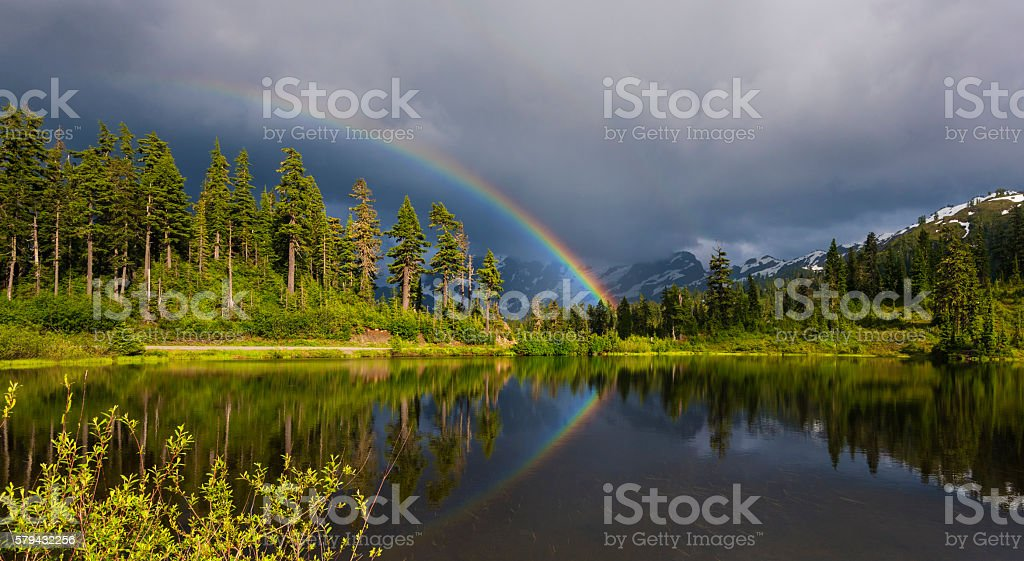Rainbow over Picture Lake. stock photo