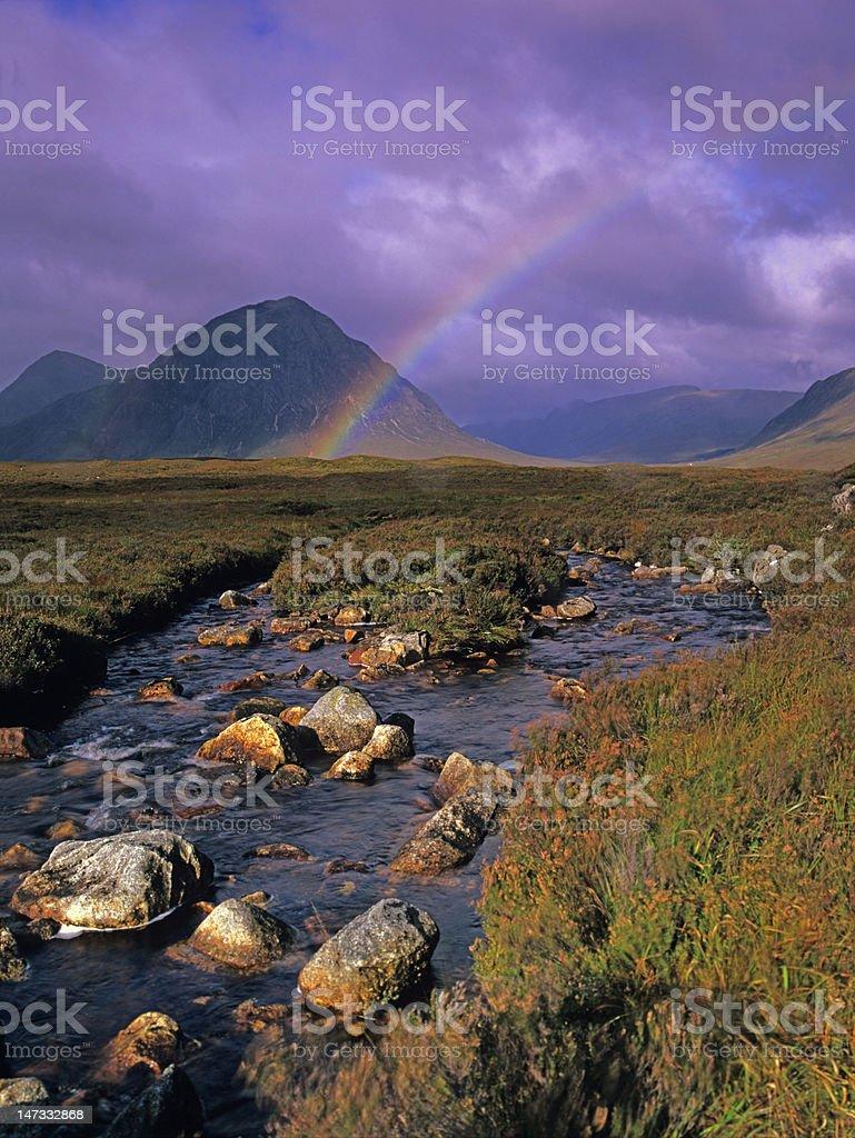 Rainbow over river Coupall and Buachaille Etive Mòr stock photo