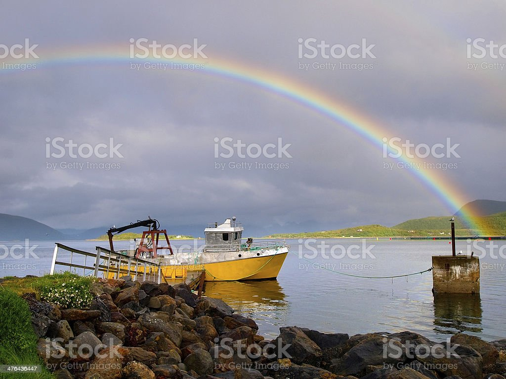 rainbow over ship stock photo