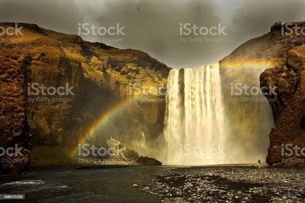 Rainbow over Skógafoss stock photo
