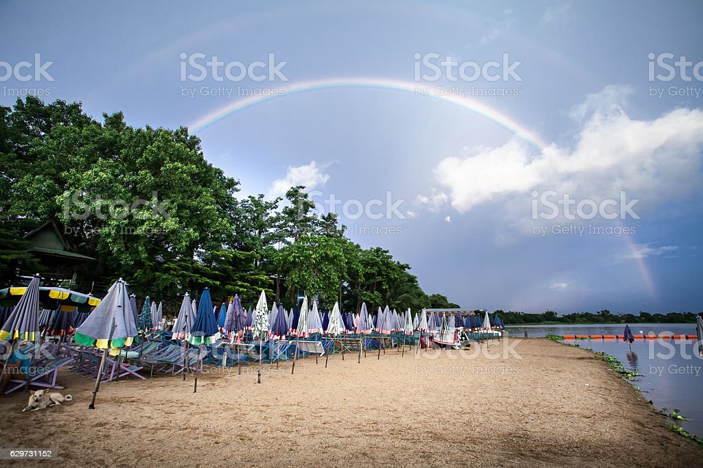 rainbow over the beach stock photo