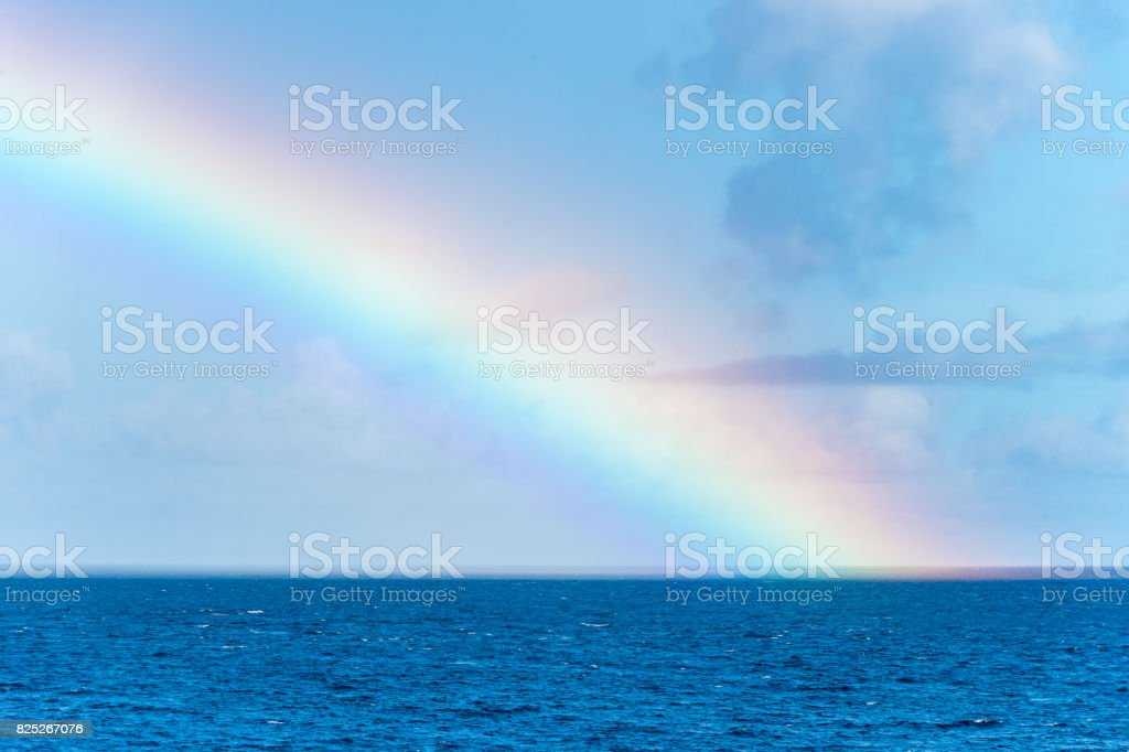 Rainbow over the Caribbean Sea in Martinique stock photo