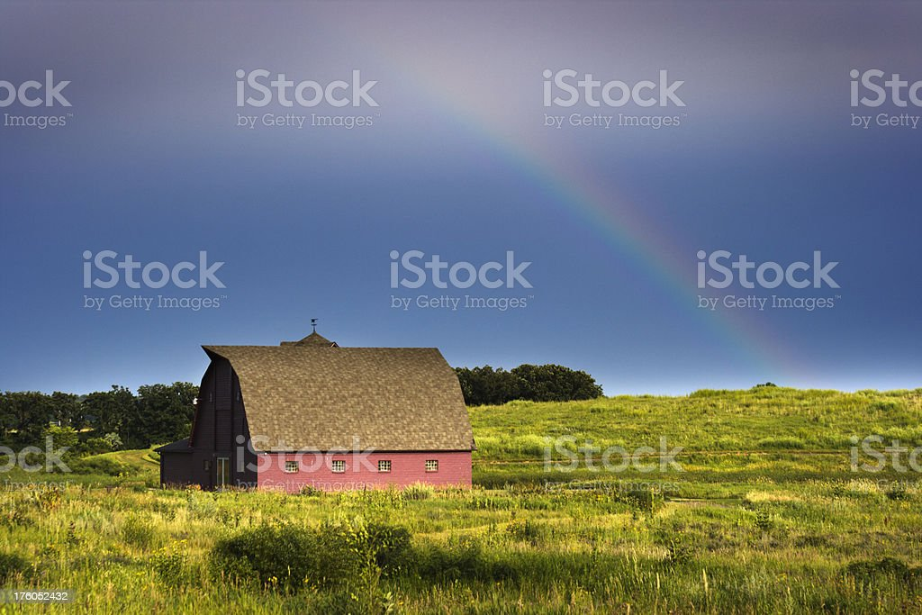 Rainbow Over the Farm and Red Barn stock photo