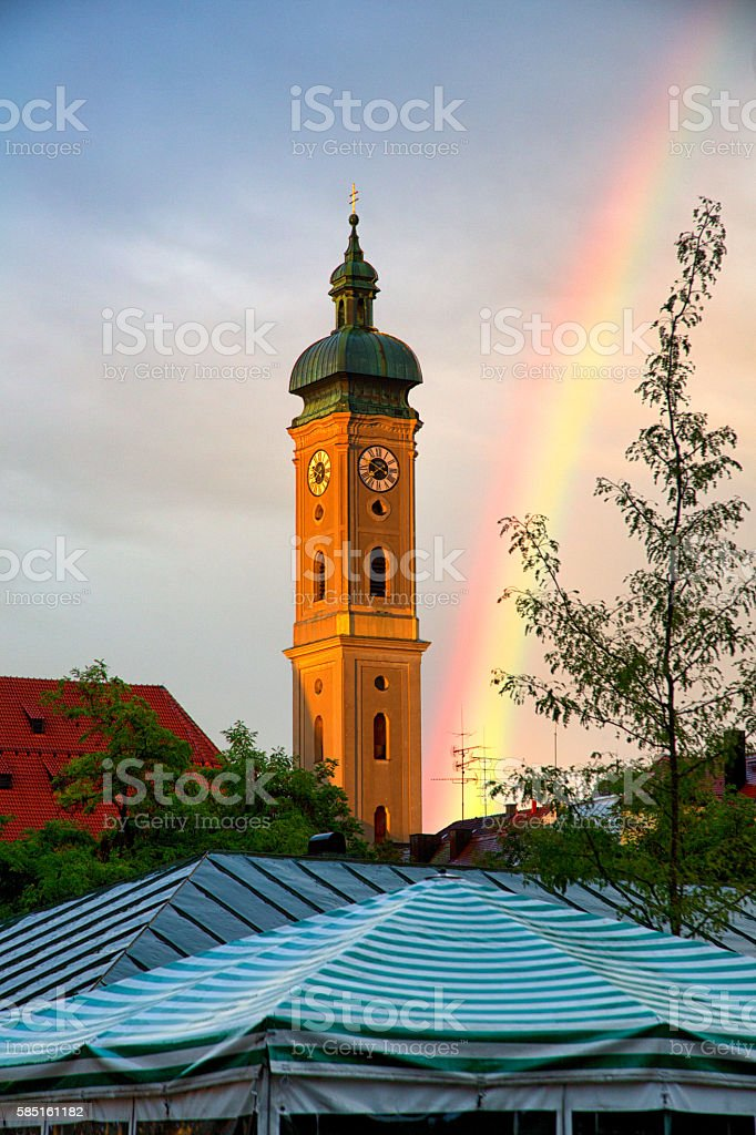 Rainbow Over The Heiliggeistkirche Clock Tower Of Munich stock photo