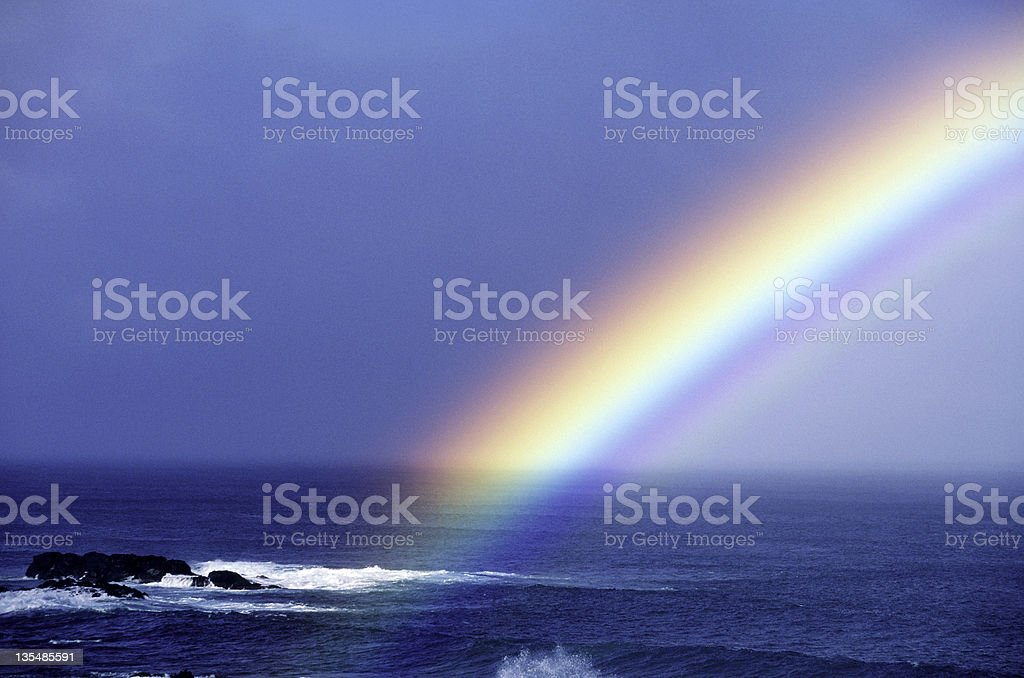 Rainbow over the pacific ocean near Oahu Hawaii USA royalty-free stock photo