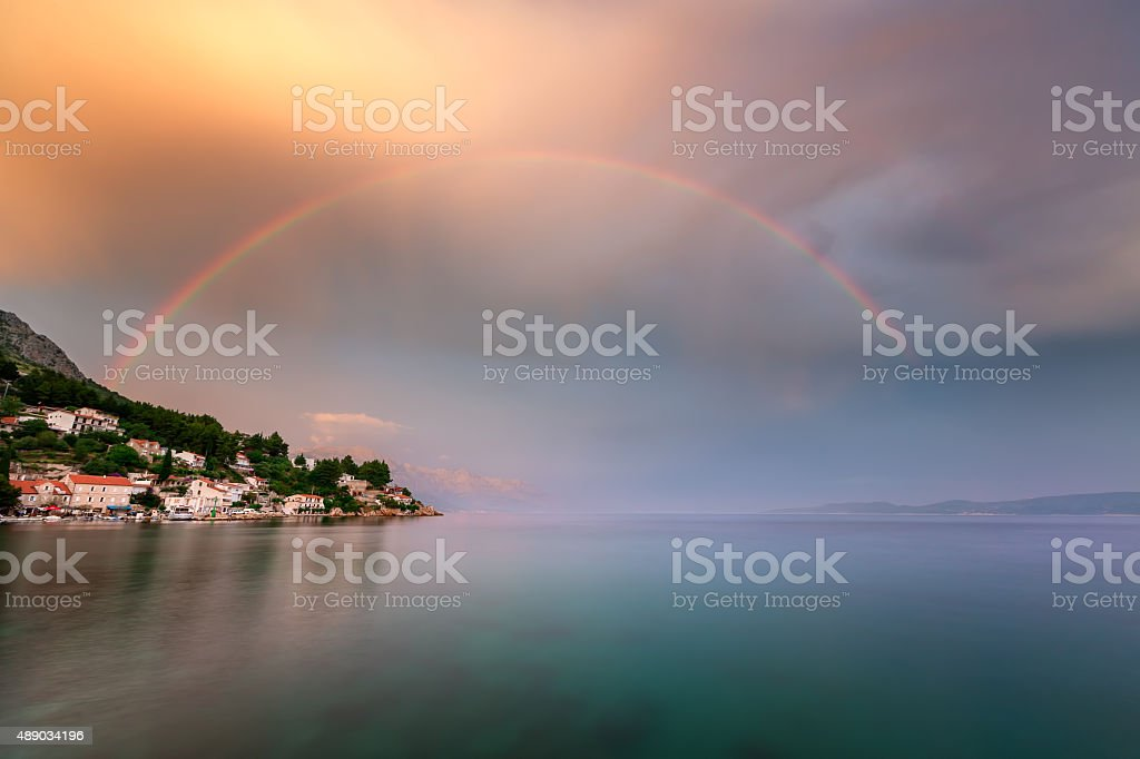 Rainbow over the Small Village in Omis Riviera stock photo