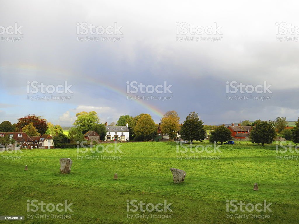 Rainbow over village, UK royalty-free stock photo