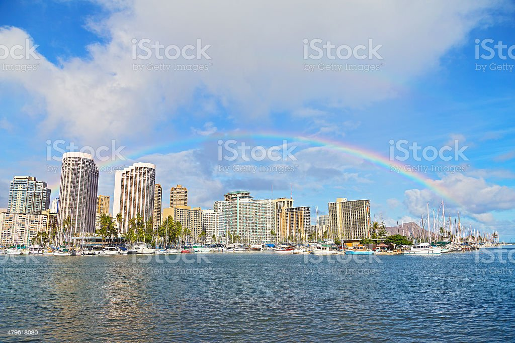 Rainbow over Waikiki beach resort and marina, Honolulu, Hawaii, USA. stock photo