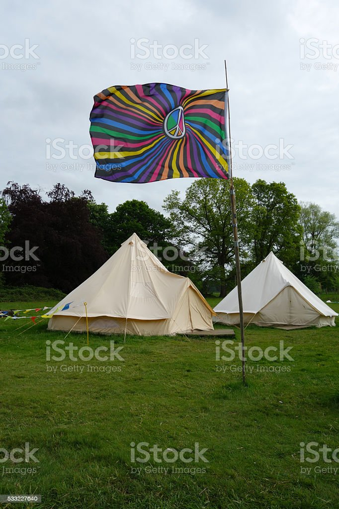 Rainbow peace flag flying in front of peace camp stock photo
