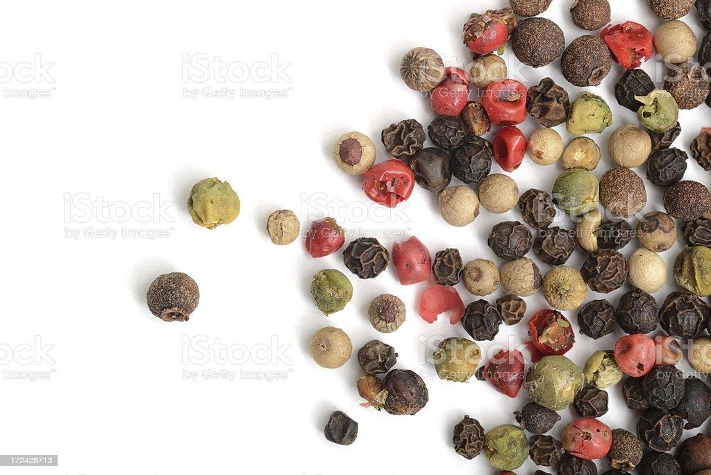 Rainbow peppercorns scattered stock photo