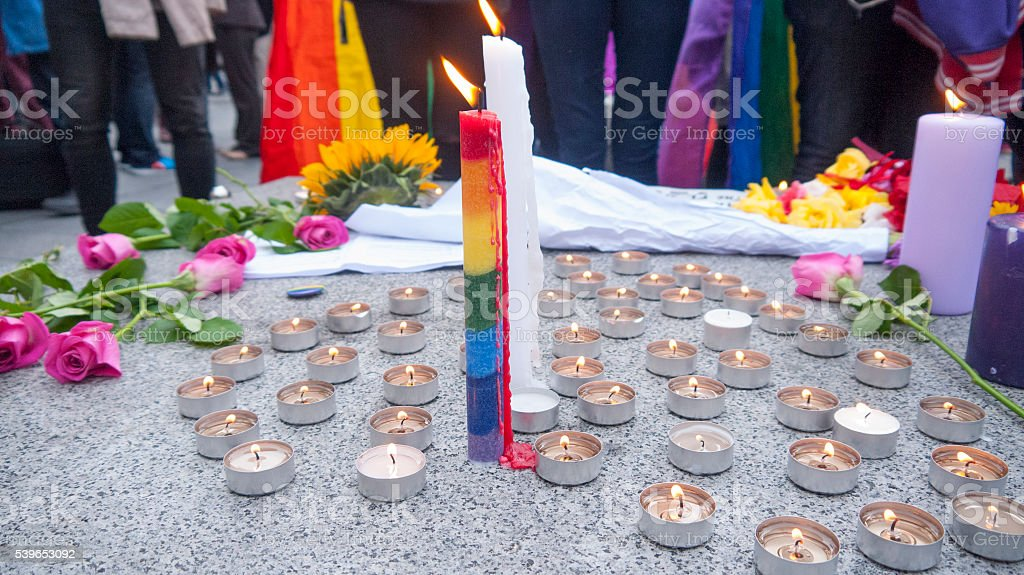 Rainbow pride candle and flowers stock photo