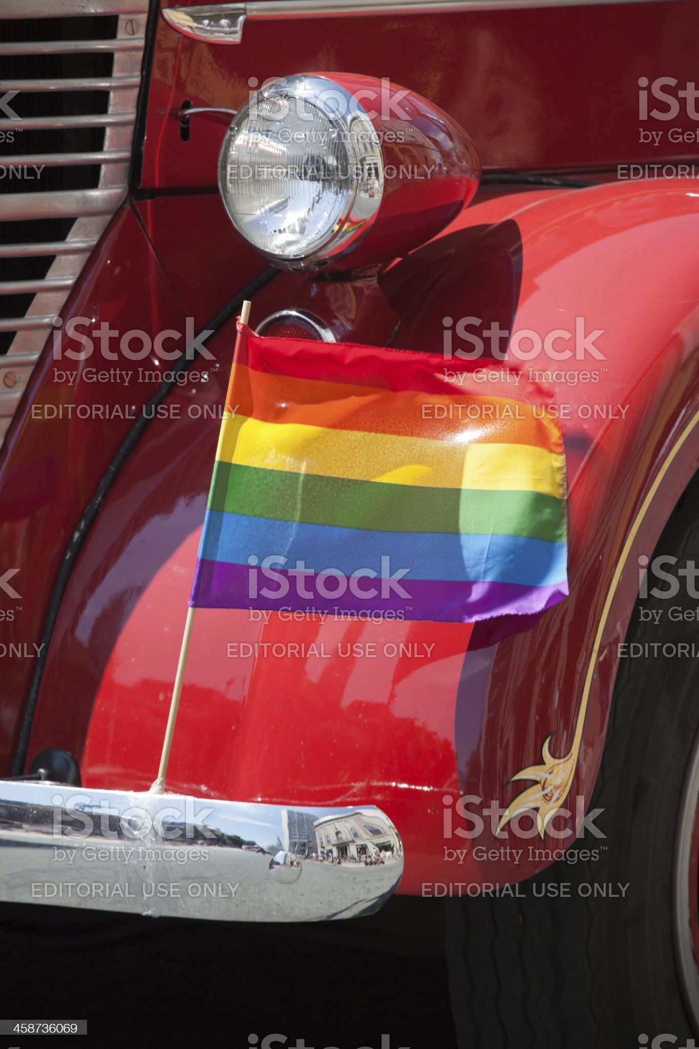 Rainbow Pride Flag on Antique Fire Truck royalty-free stock photo