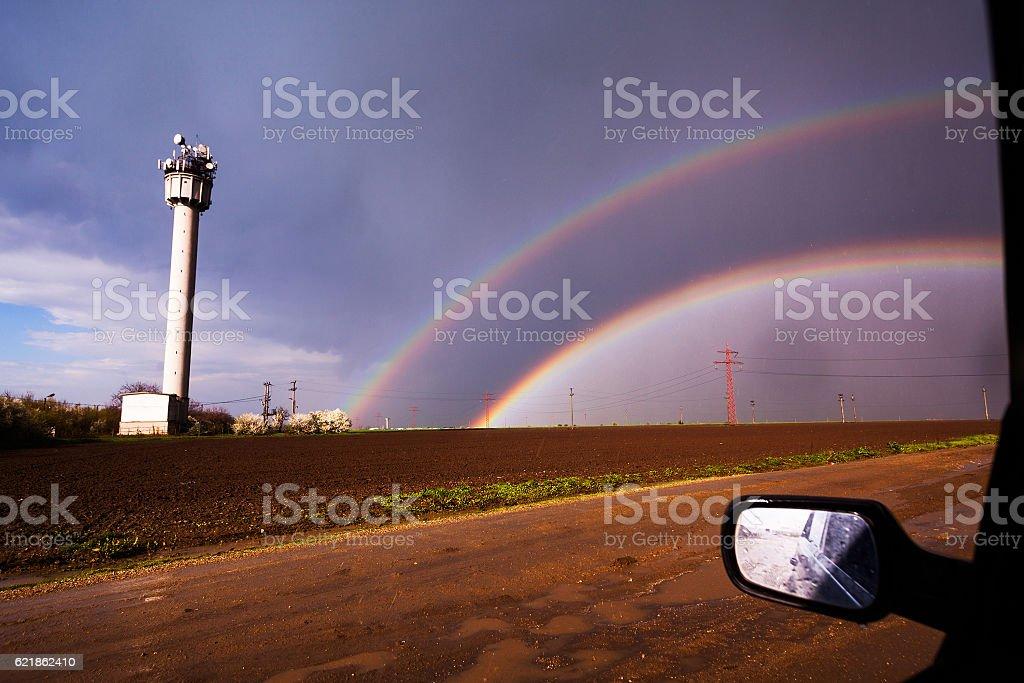 Rainbow seen from car stock photo