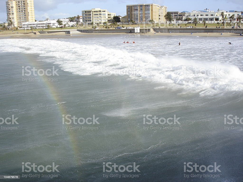 Rainbow seen in the surf spray stock photo