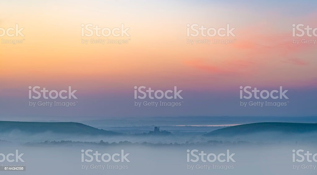 Rainbow skies in the Dorset Purbeck Hills above Corfe Castle stock photo
