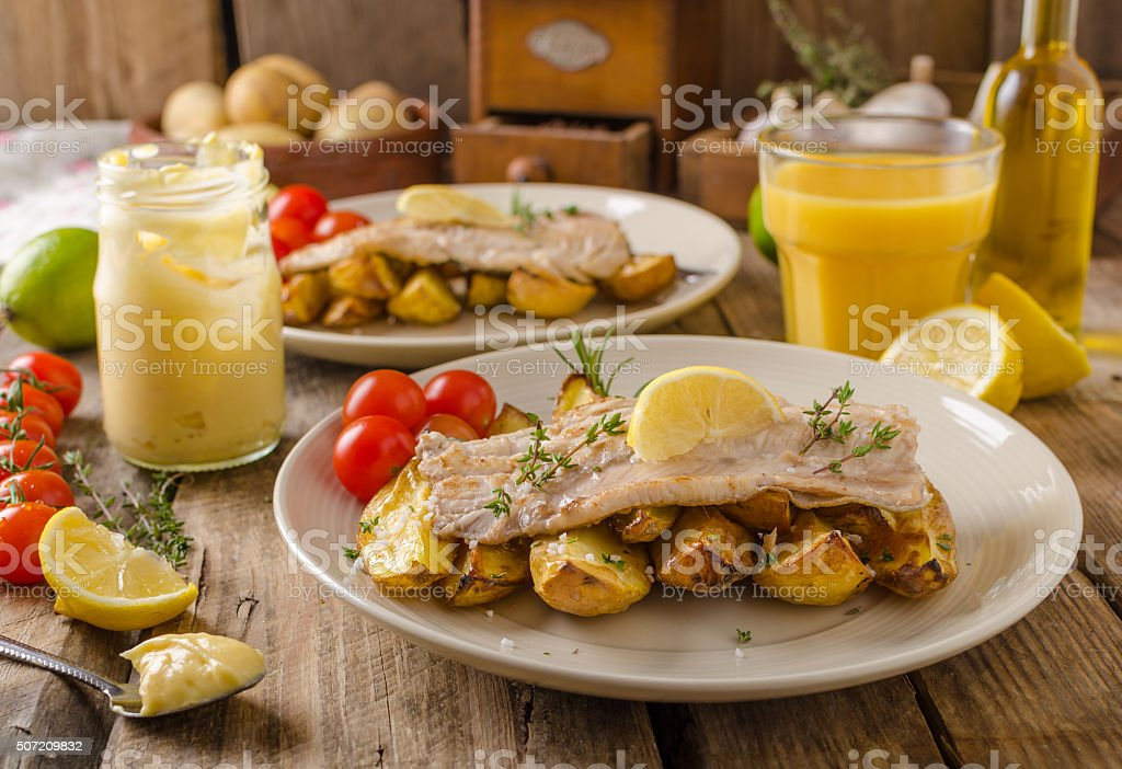 Rainbow trout fillet with roasted potatoes stock photo
